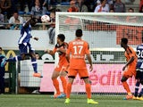 Evian's Ivorian Burkinabese midfielder Djakaridja Kone (L) scores a goal during the French L1 football match between Lorient (FCL) and Evian Thonon Gaillard (ETGFC) on September 27, 2014