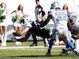 Eric Decker #87 of the New York Jets scores a touchdown in the third quarter against the Detroit Lions defense on September 28, 2014