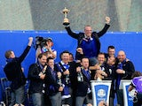The victorious European Ryder Cup team celebrate with the trophy after the Singles Matches of the 2014 Ryder Cup on the PGA Centenary course at Gleneagles on September 28, 2014