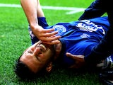 Kevin Mirallas of Everton pulls up with a hamstring injury during the Barclays Premier League match between Liverpool and Everton at Anfield on September 27, 2014