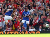 Phil Jagielka of Everton scores a late goal to level the scores at 1-1 during the Barclays Premier League match between Liverpool and Everton at Anfield on September 27, 2014