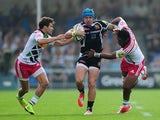 Jack Nowell of Exeter Chiefs is tackled by Ollie Lindsay-Hague and Asaeli Tikoirotuma of Harlequins during the Aviva Premiership match between Exeter Chiefs and Harlequins at Sandy Park on September 28, 2014