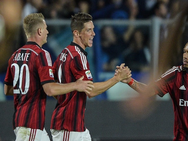 AC Milan's Spanish forward Fernando Torres celebrates after scoring during the Italian Serie A football match Empoli vs AC Milan on September 23, 2014