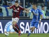 AC Milan's Spanish forward Fernando Torres (L) fights for the ball with Empoli's midfielder Mirko Valdifiori during the Italian Serie A football match Empoli vs AC Milan on September 23, 2014