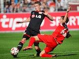 Leverkusen's midfielder Lars Bender vies with Freiburg's midfielder Julian Schuster during the German first division Bundesliga football match SC Freiburg vs Bayer 04 Leverkusen in Freiburg, southwestern Germany on September 27, 2014