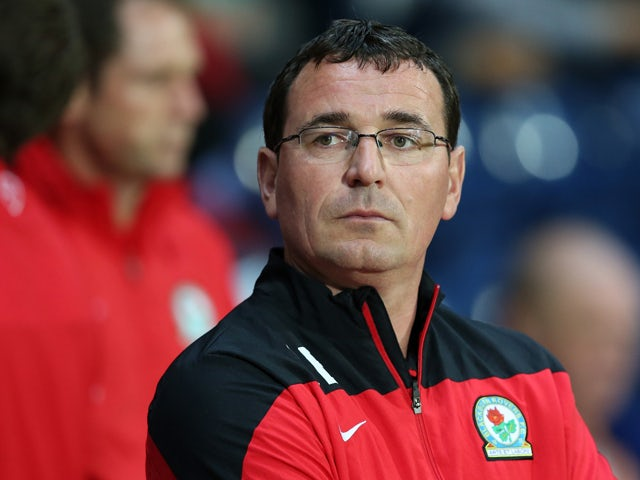 Manager of Blackburn Rovers Gary Bowyer looks on during the Sky Bet Championship match between Blackburn Rovers and Derby County at Ewood Park on September 17, 2014