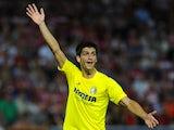 Villarreal's forward Gerard Moreno reacts during the Spanish league football match Granada CF vs Villarreal CF at the Nuevo Los Carmenes stadium in Granada on September 14, 2014.