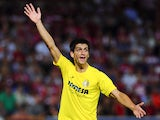 Villarreal's forward Gerard Moreno reacts during the Spanish league football match Granada CF vs Villarreal CF at the Nuevo Los Carmenes stadium in Granada on September 14, 2014.