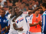 Marseille's French midfielder Giannelli Imbula (C) celebrates with teammates after scoring a goal during the French L1 football match against Saint-Etienne on September 28, 2014