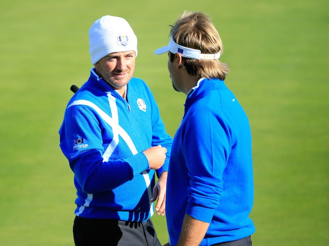 Graeme McDowell (L) talks to Victor Dubuisson of Europe on the 2nd green during the Afternoon Foursomes of the 2014 Ryder Cup on the PGA Centenary course at Gleneagles on September 26, 2014