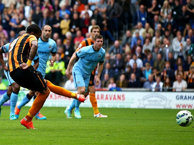 Abel Hernandez of Hull City scores from the penalty spot during the Barclays Premier League match between Hull City and Manchester City at KC Stadium on September 27, 2014