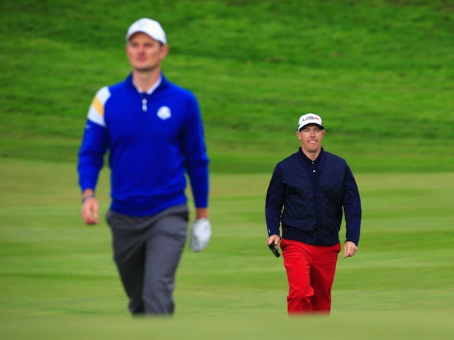 ustin Rose (L) of Europe and Hunter Mahan of the United States walk on the 1st hole during the Singles Matches of the 2014 Ryder Cup on the PGA Centenary course at Gleneagles on September 28, 2014