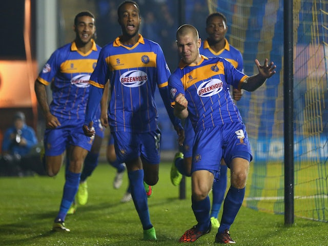 James Collins (R) of Shrewsbury Town celebrates scoring the opening goal during the Capital One Cup Third Round match against Norwich City on September 23, 2014