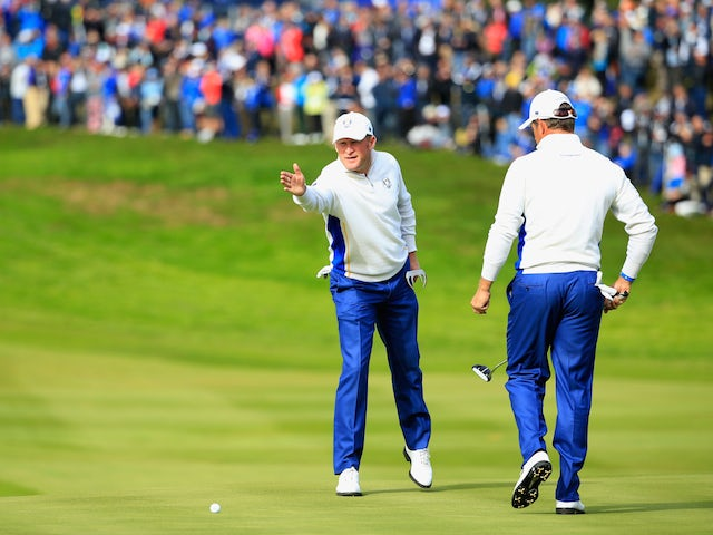 Jamie Donaldson (L) and Lee Westwood of Europe line up a putt on the 1st hole during the Afternoon Foursomes of the 2014 Ryder Cup on the PGA Centenary course at Gleneagles on September 27, 2014