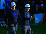Jimmy Walker (L) and Rickie Fowler of the United States line up a putt on the 3rd hole during the Morning Fourballs of the 2014 Ryder Cup on the PGA Centenary course at Gleneagles on September 26, 2014
