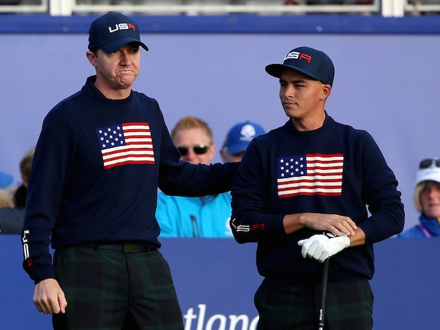 Jimmy Walker of the United States talks with partner Rickie Fowler before teeing off on the first hole during the Morning Fourballs of the 2014 Ryder Cup on the PGA Centenary course at Gleneagles on September 27, 2014