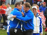 Jamie Donaldson (L) and Lee Westwood of Europe celebrate victory during the Afternoon Foursomes of the 2014 Ryder Cup on the PGA Centenary Course at Gleneagles on September 26, 2014