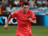 Lionel Messi of F.C. Barcelona controls the ball during the La Liga match between Malaga CF and FC Barcelona at La Rosaleda studium on September 24, 2014