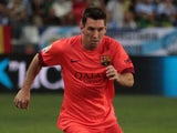 Lionel Messi of F.C. Barcelona controls the ball during the La Liga match between Malaga CF and FC Barcelona at La Rosaleda studium on September 24, 2014