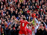 Steven Gerrard #8 of Liverpool infront of the home fans after scoring the opening goal from a free kick during the Barclays Premier League match between Liverpool and Everton at Anfield on September 27, 2014