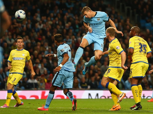 Edin Dzeko of Manchester City scores his sides fifth goal during the Capital One Cup Third Round match between Manchester City and Sheffield Wednesday at the Etihad Stadium on September 24, 2014
