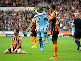 Edin Dzeko of Manchester City celebrates with team-mate David Silva after scoring his team's second goal during the Barclays Premier League match between Hull City and Manchester City at KC Stadium on September 27, 2014