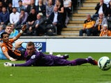 Edin Dzeko of Manchester City scores his team's third goal past Allan McGregor of Hull City during the Barclays Premier League match between Hull City and Manchester City at KC Stadium on September 27, 2014