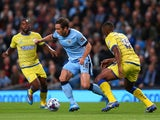 Frank Lampard of Manchester City beats Kamil Zayatte of Sheffield Wednesday during the Capital One Cup Third Round match between Manchester City and Sheffield Wednesday at Etihad Stadium on September 24, 2014