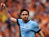 Manchester City's English midfielder Frank Lampard celebrates scoring their fourth goal during the English Premier League football match between Hull City and Manchester City at the KC Stadium in Kingston-Upon Hull on September 27, 2014