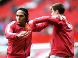 Radamel Falcao Garcia of Manchester United warms up with team-mate Paddy McNair before the Barclays Premier League match between Manchester United and West Ham United at Old Trafford on September 27, 2014