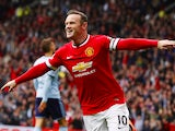 Manchester United's English striker Wayne Rooney celebrates scoring the opening goal during the English Premier League football match between Manchester United and West Ham United at Old Trafford in Manchester on September 27, 2014