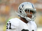 Maurice Jones-Drew #21 of the Oakland Raiders warms up prior to a preseason game against the Green Bay Packers at Lambeau Field on August 22, 2014