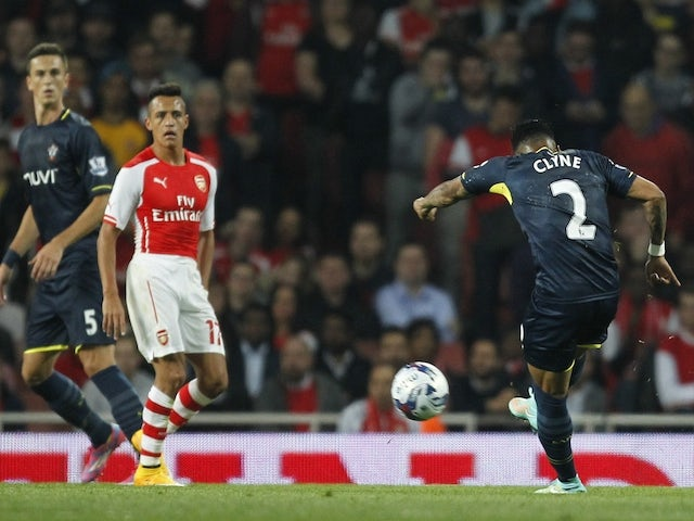 Southampton's English defender Nathaniel Clyne (R) shoots to score their second goal during the English League Cup third round football match against Arsenal on September 23, 2014