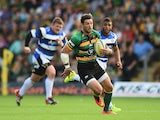 Ben Foden of Northampton Saints breaks with the ball during the Aviva Premiership match between Northampton Saints and Bath Rugby at Franklin's Gardens on September 27, 2014