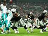 Sebastian Janikowski #11 of the Oakland Raiders adds the extra point to the touchdown scored by teammate Brian Leonhardt #87 of the Oakland Raiders during the NFL match between the Oakland Raiders and the Miami Dolphins at Wembley Stadium on September 28,