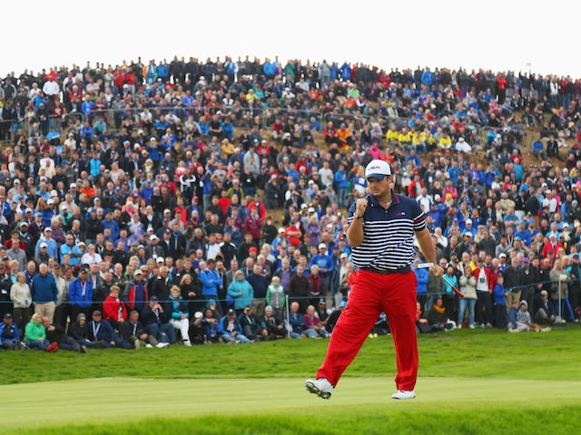 Patrick Reed of the United States celebrates on the 8th green during the Singles Matches of the 2014 Ryder Cup on the PGA Centenary course at Gleneagles on September 28, 2014