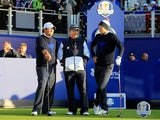 USA trio Patrick Reed, captain Tom Watson and Jordan Spieth look on from the 1st tee during the Morning Fourballs of the 2014 Ryder Cup on the PGA Centenary course at Gleneagles on September 26, 2014