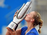 Petra Kvitova of the Czech Republic kisses the trophy after her win over Eugenie Bouchard of Canada in the final of the Wuhan Open tennis tournament in Wuhan, in China's Hubei province on September 27, 2014.