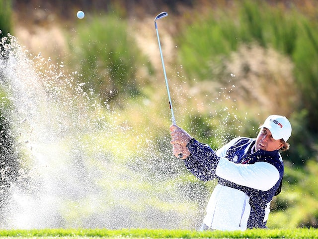 Phil Mickelson of the United States plays from a bunker on the 9th hole during the Morning Fourballs of the 2014 Ryder Cup on the PGA Centenary course at Gleneagles on September 26, 2014