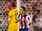 Atletico Madrid's Mexican forward Raul Jimenez celebrates after scoring during the Spanish league football match Club Atletico de Madrid vs Sevilla FC at the Vicente Calderon stadium on September 27, 2014