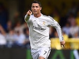 Real Madrid's Portuguese forward Cristiano Ronaldo celebrates after scoring during the Spanish league football match Villarreal CF vs Real Madrid CF at El Madrigal stadium in Villareal on September 27, 2014