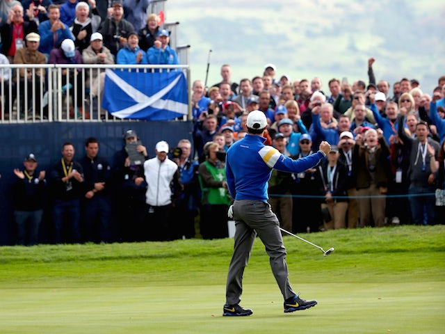 Rory McIlroy of Europe celebrates his putt on the 6th green during the Singles Matches of the 2014 Ryder Cup on the PGA Centenary course at Gleneagles on September 28, 2014