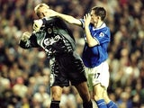 Sander Westerveld of Liverpool wrestles with Francis Jeffers of Everton during the FA Premier League match between Liverpool and Everton at Anfield on September 27, 1999