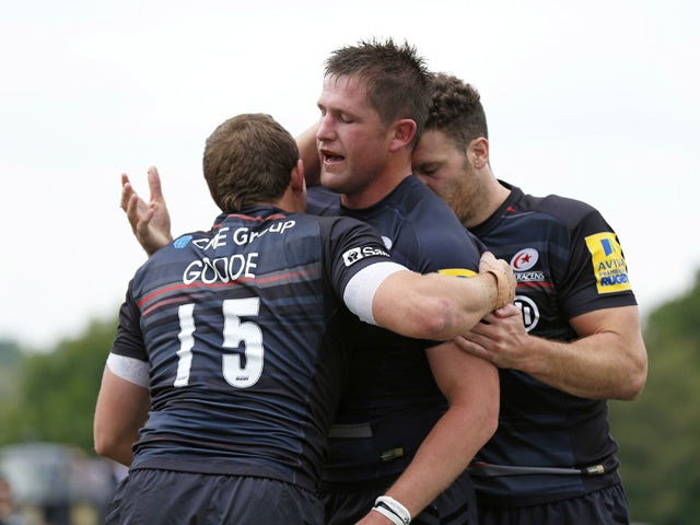 Ernst Joubert of Saracens celebrates scoring a try with Alex Goode during the Aviva Premiership match between Saracens and Sale Sharks at Allianz Park on September 27, 2014