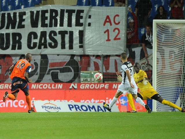 Montpellier's forward Souleymane Camara (L) scores a goal during the French L1 football match between Montpellier and Guingamp on September 27, 2014