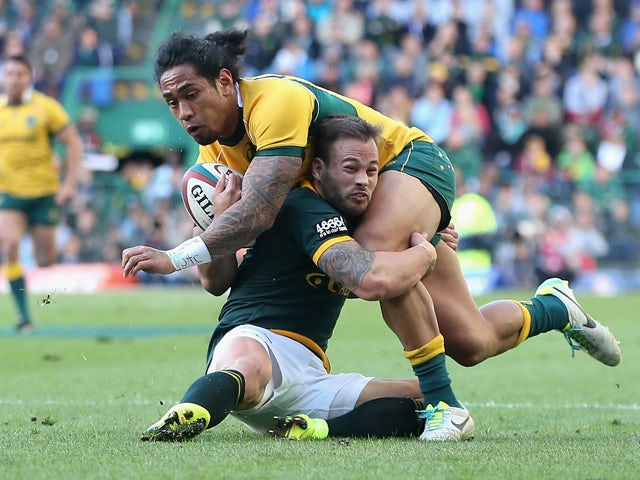 Joe Tomane of the Wallabies is tackled by Francois Hougaard during The Rugby Championship match between the South African Springboks and the Australian Wallabies at Newlands Stadium on September 27, 2014