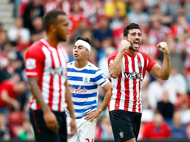 Graziano Pelle of Southampton celebrates scoring their second goal during the Barclays Premier League match between Southampton and Queens Park Rangers at St Mary's Stadium on September 27, 2014