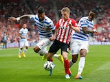 Steven Davis of Southampton vies with Armand Traore and Leroy Fer of QPR during the Barclays Premier League match between Southampton and Queens Park Rangers at St Mary's Stadium on September 27, 2014