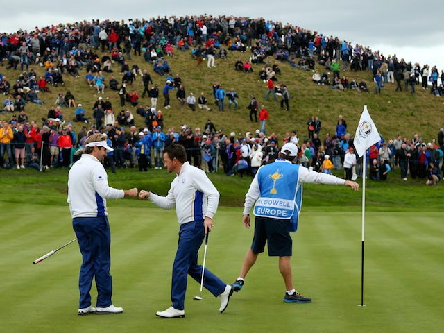 Victor Dubuisson and Graeme McDowell of Europe celebrate on the 3rd green during the Afternoon Foursomes of the 2014 Ryder Cup on the PGA Centenary course at Gleneagles on September 27, 2014