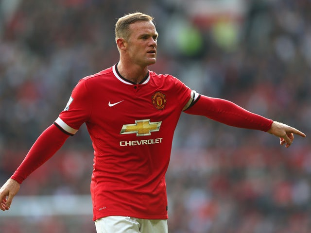 Wayne Rooney of Manchester United gestures during the Barclays Premier League match between Manchester United and Queens Park Rangers at Old Trafford on September 14, 2014